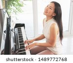 Beautiful Asian Pianist Woman...