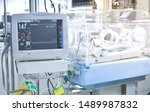 a sick baby in a hospital room... | Shutterstock . vector #1489987832