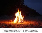 Campfire on the beach in the summer - stock photo
