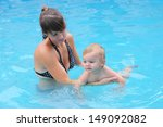 young mother with her baby boy... | Shutterstock . vector #149092082
