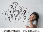 Asian Little Girl Thinking With ...