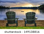 Two Wooden Chairs On Beach Of...