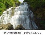 Waterfall Among The Rocks Of...