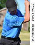 Small photo of Retiree Male Golfer Working Out With Golf Club Golf Swing