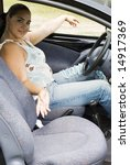 pretty woman sitting in the car - stock photo