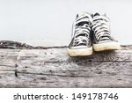 Black Sneakers On The Old Log...