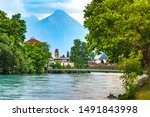 Panoramic view of Old City of Unterseen with Church and Aare river, Interlaken, important tourist center in the Bernese Highlands, Switzerland