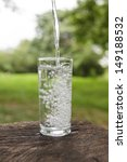 pouring water into a glass in... | Shutterstock . vector #149188532