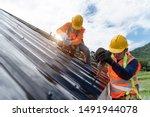 Technician Is Work Roof Repair...