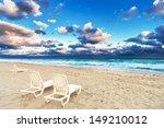 deckchairs on a beach on a... | Shutterstock . vector #149210012