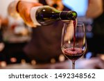 Pouring Glass Of Red Wine From...