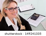young businesswoman calculating ... | Shutterstock . vector #149241335