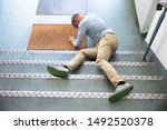 Mature Man Lying On Staircase...
