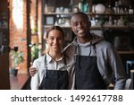 happy diverse waiter and... | Shutterstock . vector #1492617788