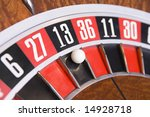 Stock photo close up of ball on roulette wheel in number thirteen 14928718