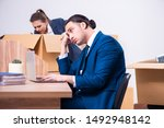 two employees being fired from... | Shutterstock . vector #1492948142