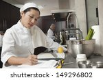 middle aged female chef writing ... | Shutterstock . vector #149296802