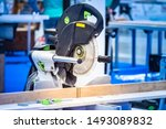 Stationary circular saw. Joiner's workshop. Circular saw cuts a tree. Professional carpentry tools. Lumber processing. Tool for decorating. circular saw at workplace. Wood cutting. Joinery biznes. - stock photo