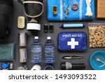 Small photo of Preppers are known for preparing for natural disasters,economic collapse,civil unrest or any doomsday scenario.Such items would include food,water,lighting,shelter,and a first aid kit.Bug out kit.
