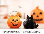 Stock photo black cat with candies in halloween bucket 1493106842