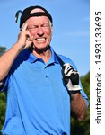 Small photo of Male Golfer Making A Decision With Golf Club Golfing