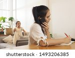 asian mother busy working at... | Shutterstock . vector #1493206385