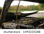 Burnt car close-up at the pond. Wanted criminal vehicle. Criminal auto, stolen and burned at the water. - stock photo