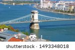 TILT SHIFT EFFECT - Panorama of Budapest, Hungary, with the The Szechenyi Chain Bridge, the Hungarian Parliament building and other buildings along Danube river, Hungary.