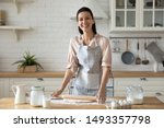 Woman Wearing Apron Smiling...