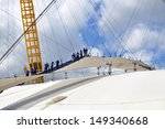 Small photo of LONDON - AUGUST 3. Climbers on the O2 Arena entertainment dome 53 metre (174 feet) high 'Roof Walk', a fabric walkway suspended from masts on August 3, 2013, on the Greenwich Peninsula, London, UK.