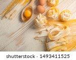 raw yellow italian pasta... | Shutterstock . vector #1493411525