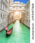 Small photo of Bridge of Sighs (Ponte dei Sospiri) and row of gondolas with gondoliers and Rio de Palazzo o de Canonica Canal from Riva degli Schiavoni in Venice, Italy. Ponte de la Canonica is visible in background