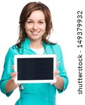 Young cheerful woman doctor is showing her blank tablet, isolated over white - stock photo
