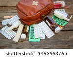 First Aid Kit On Old Wooden...