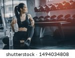 Fit Young Woman Sitting And...