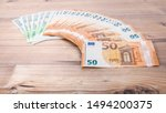 Small photo of Euro banknotes. 50 euro euro money. Money finance earning sector concept. Cash money on wooden background. Euro bank notes Laid out in a semicircle.