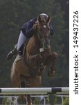 Horse jump a hurdle in a competition - stock photo