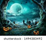 Small photo of Jack 'O Lantern In Cemetery In Spooky Night With Full Moon - Halloween