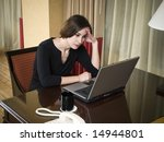 A Businesswoman Works Late Int...