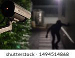 Small photo of CCTV surveillance camera operate during night capture thief while break into a house