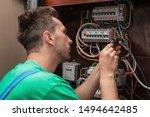 Electrician Installing Alarm...