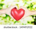 heart in hands on nature... | Shutterstock . vector #149491922