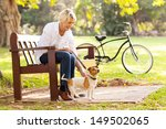 Stock photo happy mature woman with pet dog outdoors 149502065