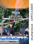 Small photo of Waddinxveen, Netherlands - SEPTEMBER 2, 2019: Men fillip hot air balloon with fire. Hot air balloons are released in the Gouwebos in Waddinxveen, The Netherlands.