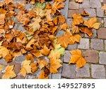 Autumn Leaves On A Cobblestone...
