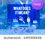 Handwriting text writing What Does It Mean question. Concept meaning intended to communicate unclear statement man icons smartphone speech bubble office supplies technological device.