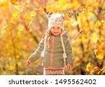 Cute little girl in an autumn...