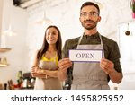 Stock photo opening own cafeteria handsome bearded husband standing near wife while opening their own cafeteria 1495825952