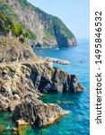 Rocky coast near Riomaggiore with part of the Love Road (Via dell