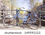 old bike on a bridge in... | Shutterstock . vector #149592122